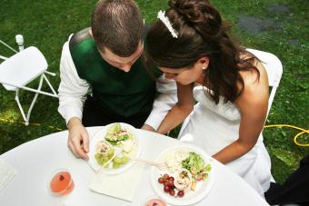 Bride and groom praying before their meal