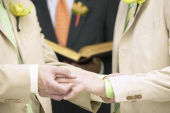 Man placing ring on another's finger