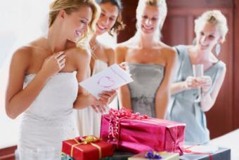 Bride reading card with bridesmaids
