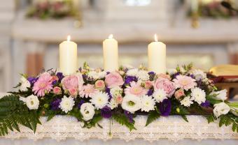 Unity candle flower arrangement on altar