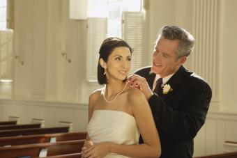 Father fastening brides necklace