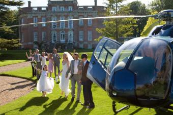 newlyweds about to board helicopter