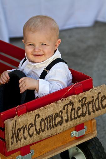 ittle boy in wagon at wedding