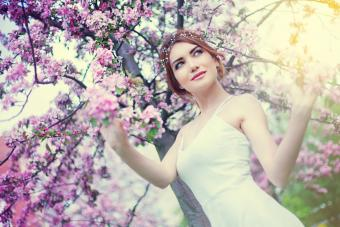 woman in park with blossoms