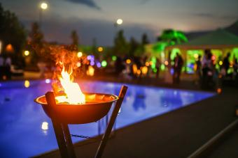 Flaming torch by evening luau pool