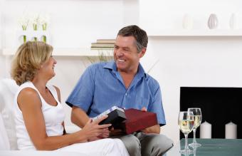 Romantic couple exchanging anniversary gifts