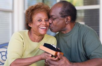 Senior woman giving watch to husband