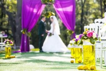 Bride and groom standing in wedding archway