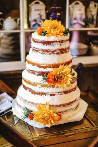 Tiered naked cake with sunflower decorations