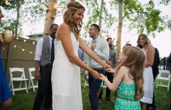 Bride and flower girl dancing