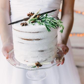 bride holding a craft cake