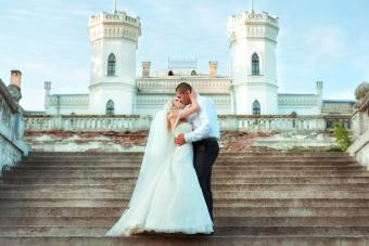 bride and groom in front of castle
