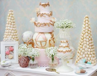 Carriage cake and elegant sweets table