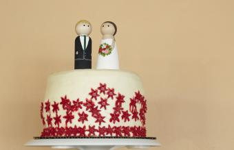 painted couple standing on cake