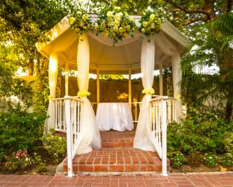 gazebo with fabric and flowers