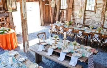 Place settings with table decorations in barn