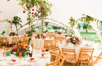 Tables in garden marquee at reception