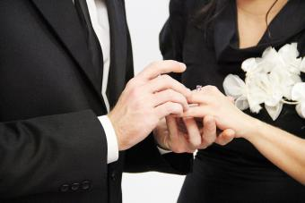 Man Putting Ring In Woman Hand