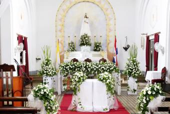 Altar with white walls, fabric, and flowers