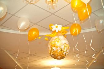 Yellow and white balloons on ceiling