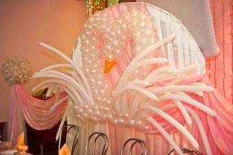Swan balloon decoration at wedding reception