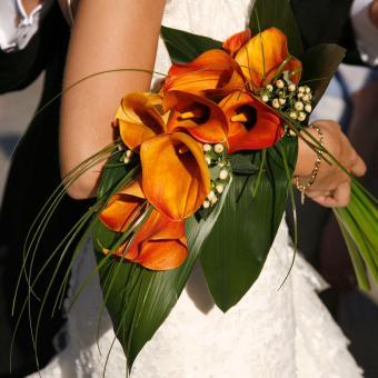 https://cf.ltkcdn.net/weddings/images/slide/241264-850x850-10-calla-lily-bridal-bouquets.jpg