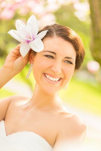 Magnolia blossom in bride's hair