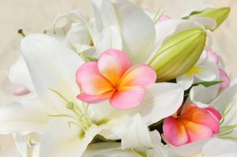 wedding bouquet of lily and pink frangipani