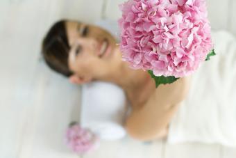 Bride holding pink hydrangea wedding bouquet