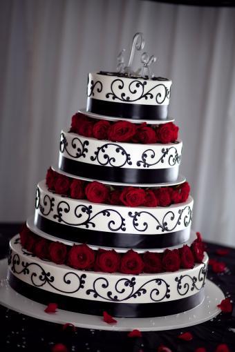 ornate black, white, red rose cake