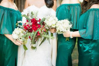 Bride With Bridesmaid Holding Bouquet