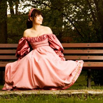 Bride in an antique rose-colored wedding gown