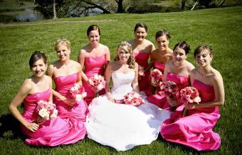 Bride with bridesmaids in bold fuchsia dresses