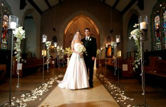 Bride and groom in decorated church