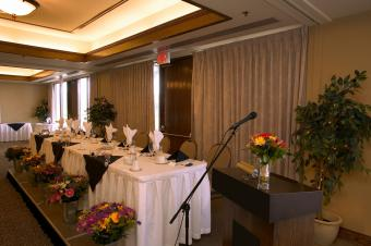 Podium with microphone next to wedding table
