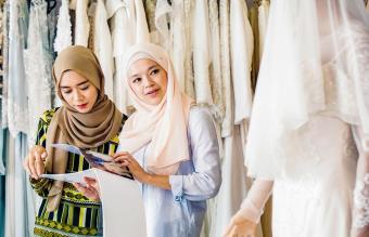 Woman Choosing Her Wedding Gown