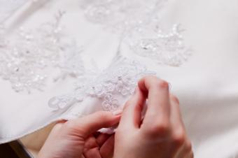 Hand sewn embellishments on wedding dress
