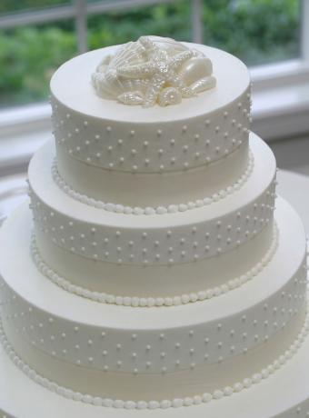 White Wedding Cake With Elegant Topper