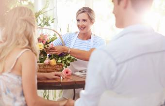 Florist talking with couple in flower shop