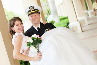 Military groom holding bride