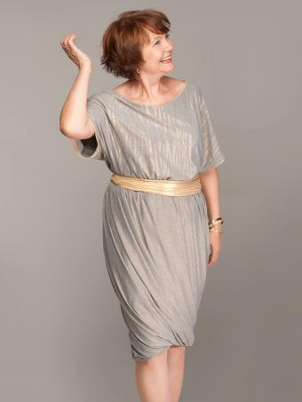 Fashionable mature woman in grey dress