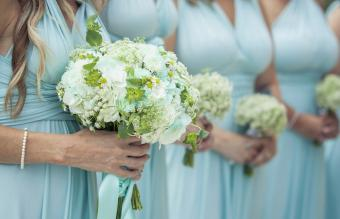 Closeup of bridesmaids holding flowers