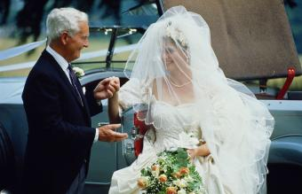 Bride being assisted by father