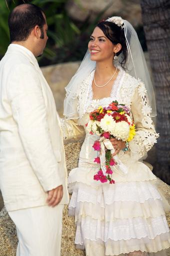 Mexican newlywed couple looking at each other