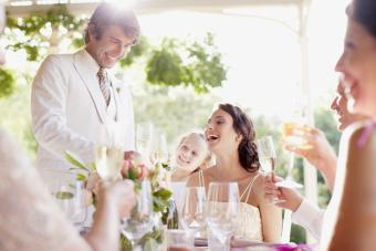 Groom giving toast at wedding reception