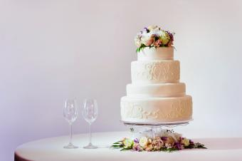 Wedding cake with wine glasses on table
