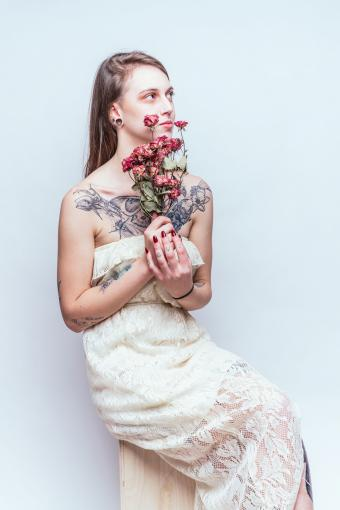 Fitted off-white dress on Goth bride