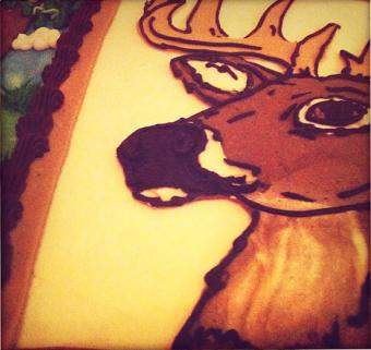 Deer design on groom's cake
