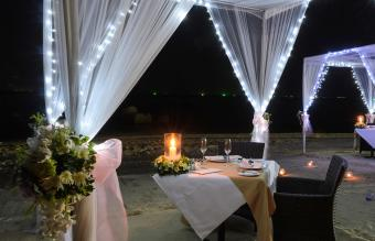Romantic dinner setup on beach at night