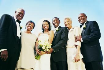 Bride and Groom Stand With Parents